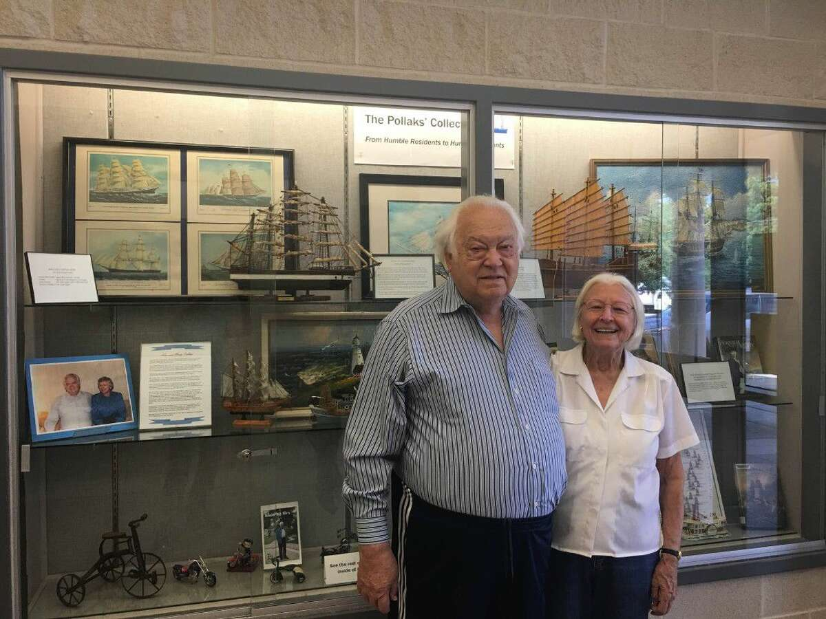 Alex and Mary Pollak in front of the display case at the front of Octavia Fields Branch Library in Humble.