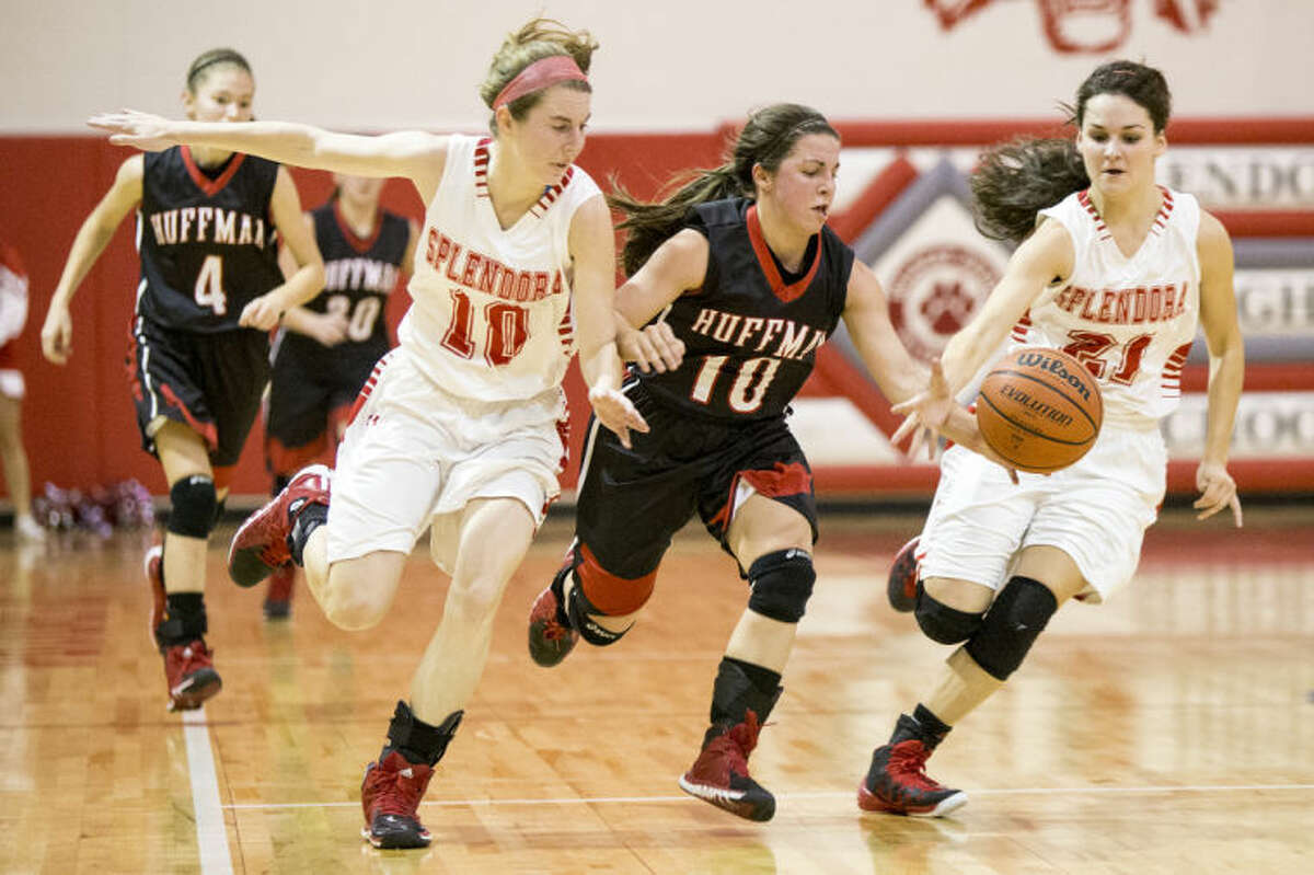 Huffman's Gloria Richmond (10) fights up the court after a steal during Splendora's victory over Huffman on Feb. 4, 2014, at Splendora High School. (Photo by ANDREW BUCKLEY/The Observer)
