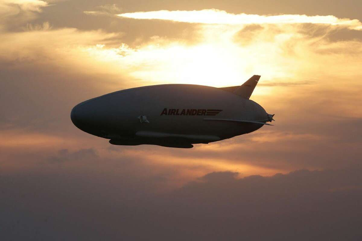 The Airlander 10 in flight, after taking off from Cardington airfield in Bedfordshire, England, Wednesday. A blimp-shaped airship billed as the world's largest aircraft has taken off for the first time, days after an earlier attempt was scuttled by a last-minute technical hitch.