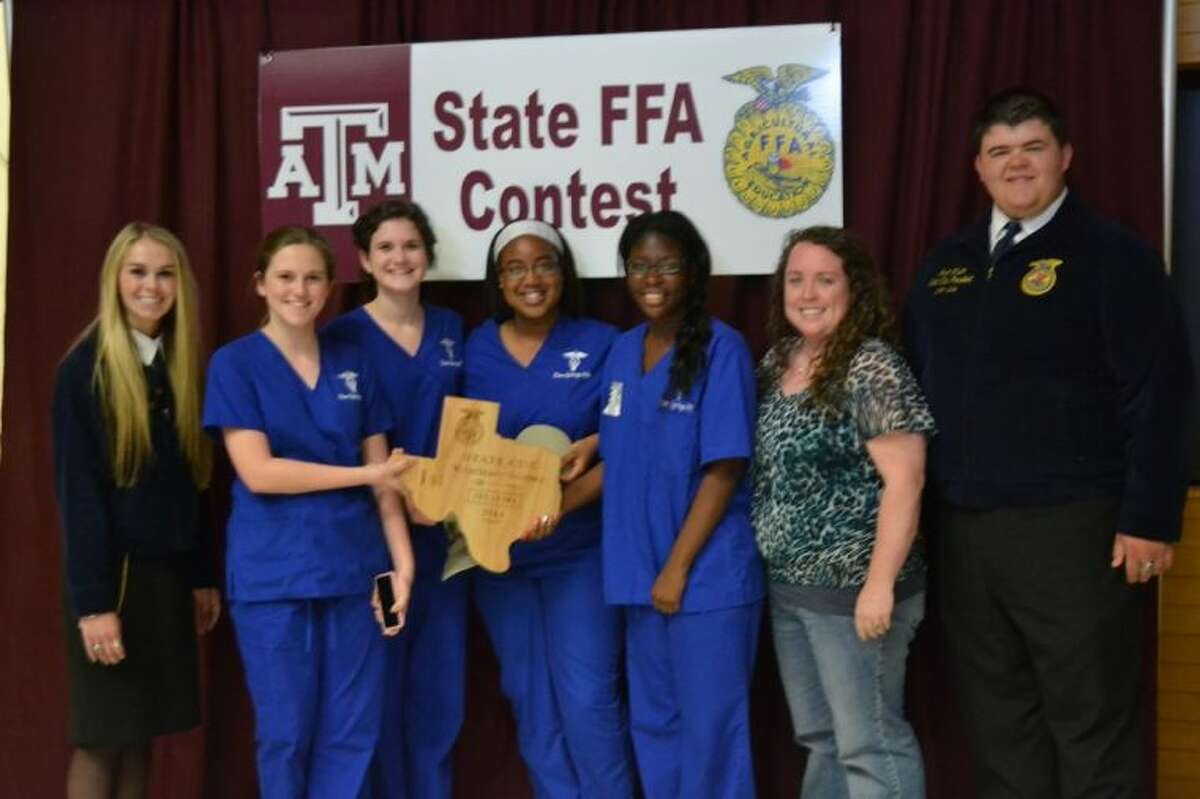 Pictured, from left FFA State Officer Heidi Ritter, Clear Springs High School students Mary Jones, Madison Barber, Lexis Coleman, and Shemica Edwards, Clear Springs High School FFA teacher Ashlie Paige and FFA State officer Rhett Wilson.