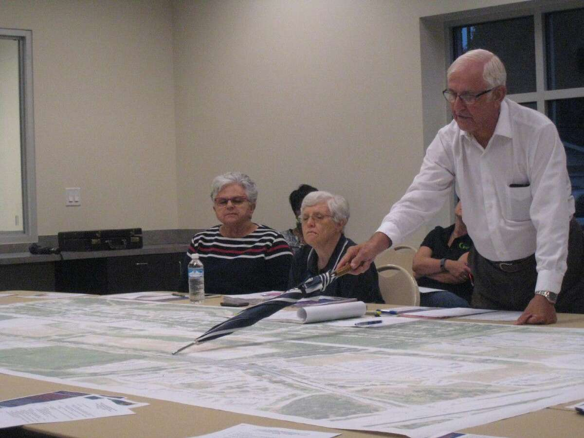 Stan Sarman, chairman for the Lake Houston Redevelopment Authority, points of specifics of the Northpark Drive Mobility Improvement Project during the Kingwood Area Super Neighborhood Council meeting Wednesday, Aug. 17, 2016.