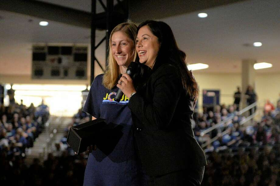 Executive director of Teach For America in Houston Tiffany Needham, right, helps present this year's Teach For America's Kinder Excellence in Teaching Award to Northbrook High School teacher Amanda Tysor during Spring Branch ISD's convocation Friday at Don Coleman Coliseum. Tysor also received a $20,000 check. Photo: Craig Moseley