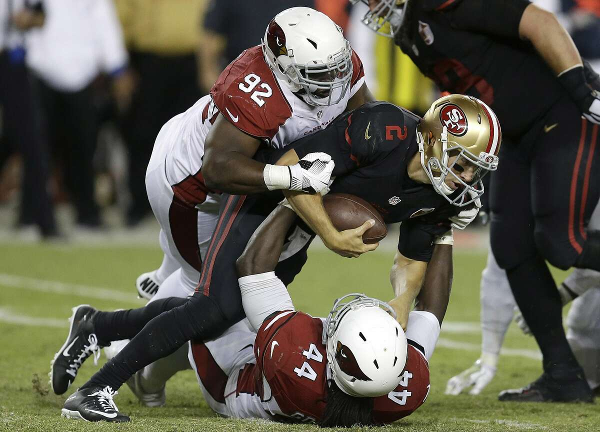 San Francisco 49ers quarterback Blaine Gabbert (2) is sacked by Arizona Cardinals outside linebacker Markus Golden (44) as defensive end Frostee Rucker (92) follows during the second half of an NFL football game in Santa Clara, Calif., Oct. 6, 2016.