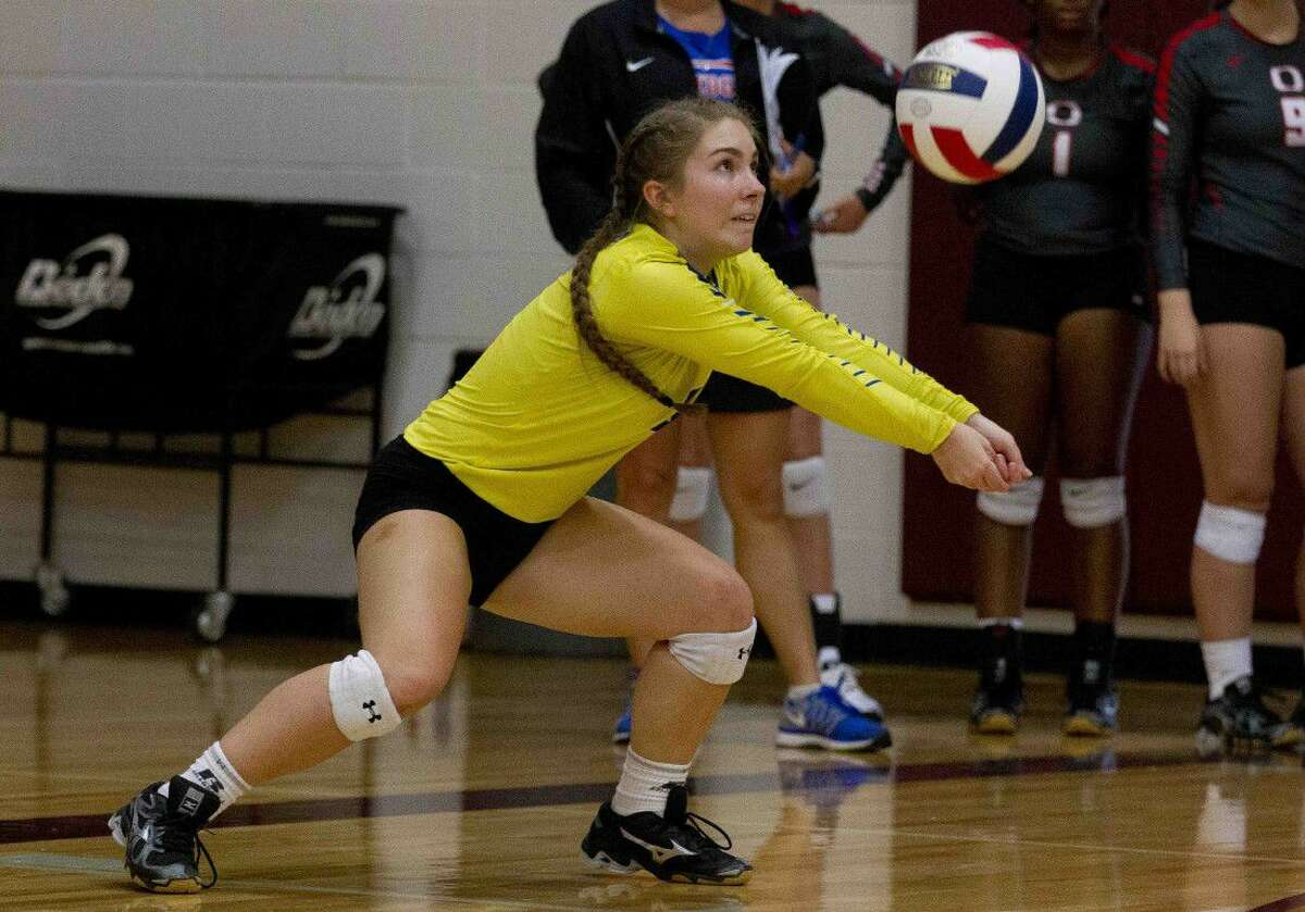 Oak Ridge libero Raigen Cianciulli returns a hit during a pool play match at the Magnolia Volley-Battle tournament Thursday at Magnolia High School. Go to HCNpics.com to purchase this photo and other like it.