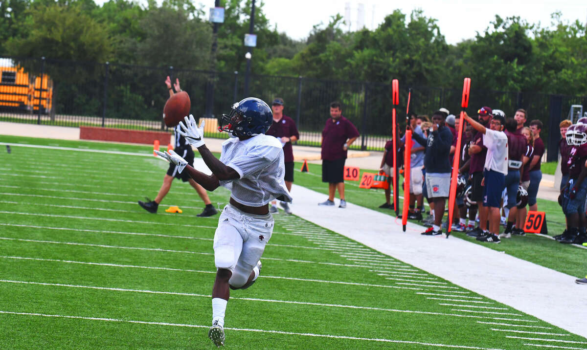 Cypress Springs senior wide receiver O'Shae Clark catches his first touchdown pass in the A&M Consolidated scrimmage Friday. Clark, whom head coach Rick Cobia praises for his verticality and explosiveness, said that, after that first touchdown, he was 'ready to go.'