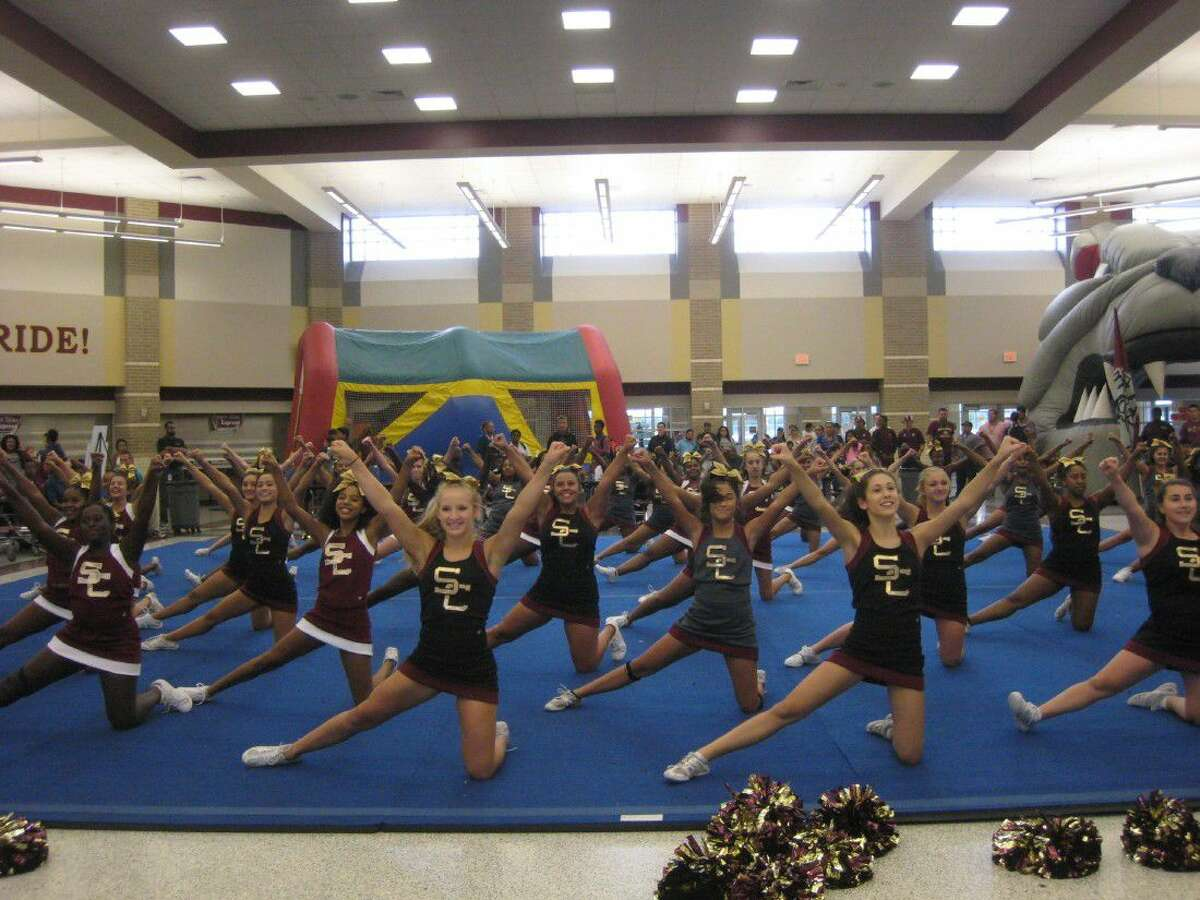 The Summer Creek High School cheerleaders perform routines for guests at the second annual Bulldogs and Hotdogs Community Celebration Thursday, Aug. 18, 2016.