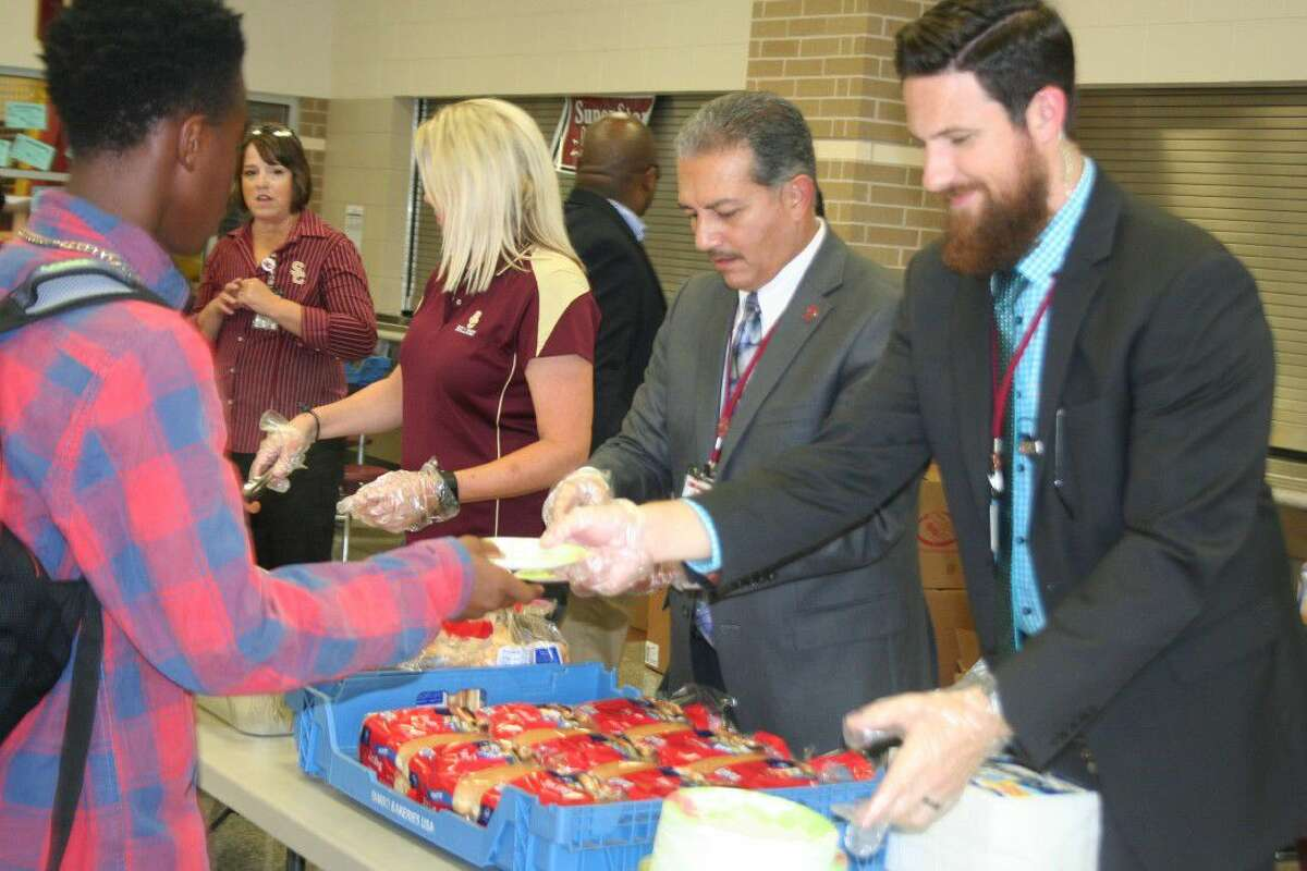 Summer Creek Principal Nolan Correa and his administrative staff even got into the spirit of the event to serve hot dogs and all of the sides to the families at the event.