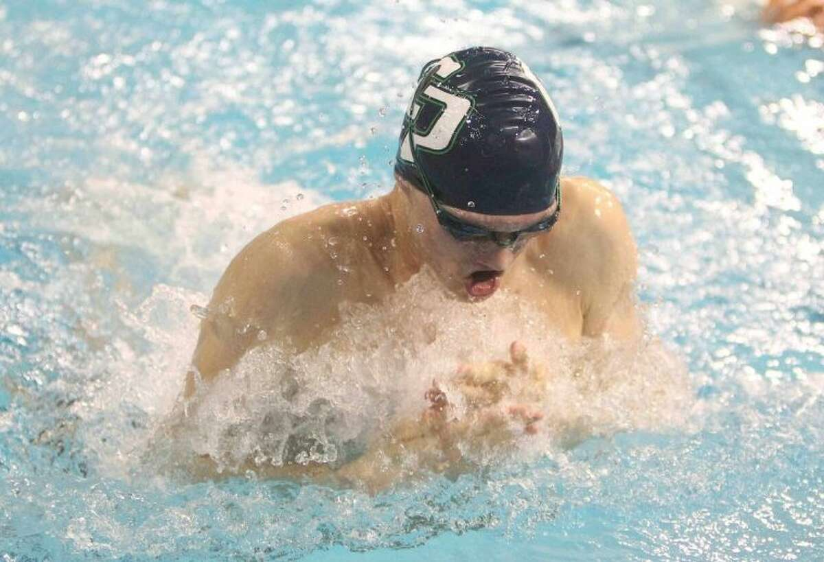 College Park's Jonathan Tybur competes in the Class 5A boys 100-yard breaststroke finals at the UIL Swimming and Diving State Championships in Austin Saturday.