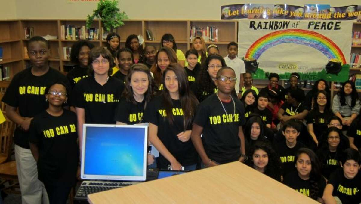 Klein Intermediate students with the 'Rock the STAAR' posters from Schindewolf.