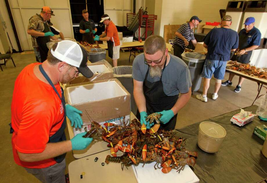 Volunteers unpack 750 lobsters in preparation for the Conroe/Lake Conroe Area Chamber of Commerce's annual Lobsterfest at Lone Star Convention Center Thursday in Conroe. Photo: Jason Fochtman, Staff / Houston Chronicle
