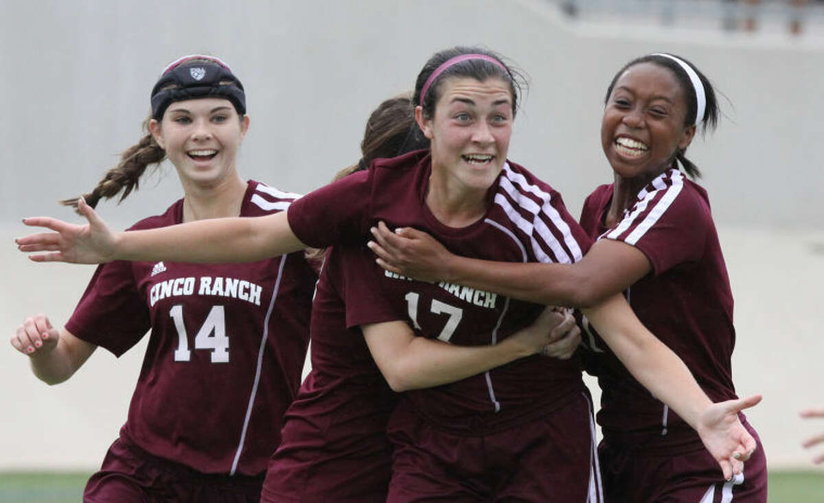 Cinco Ranch's Lauren Smith celebrates scoring a goal against Lewisville Hebron during 5A Girls State Semifinals at Birkelbach Field in Georgetown, Texas on April 17, 2014.