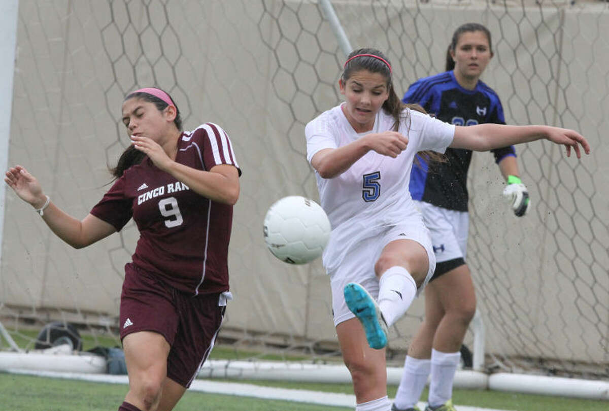 Lewisville Hebron's Cailee Dennis kicks ball away from goal against Cinco Ranch's Julianna Echavarry during 5A Girls State Semifinals at Birkelbach Field in Georgetown, Texas on April 17, 2014.