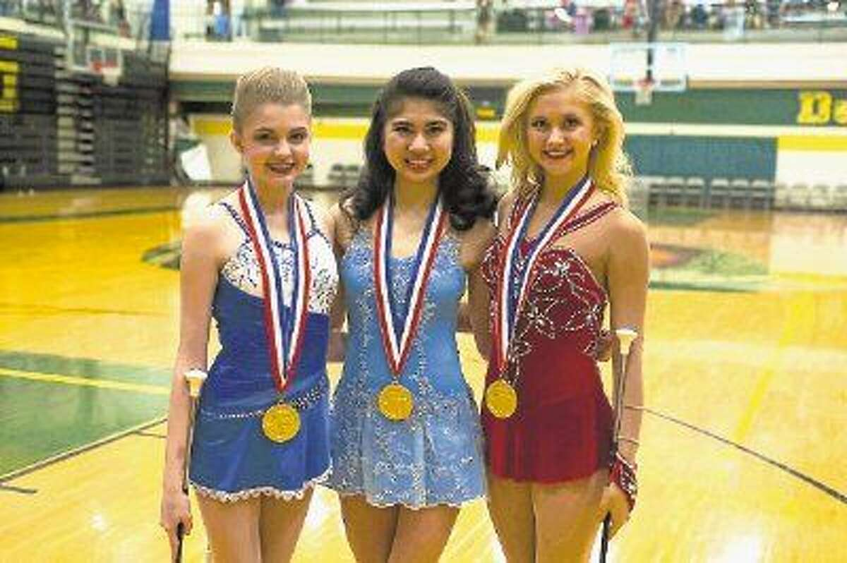 From left to right, Allie Pellerito, Feature Twirler at College Park High School, and Isabel Obias and Lindsey McCormick, Feature Twirlers at The Woodlands High School, were named