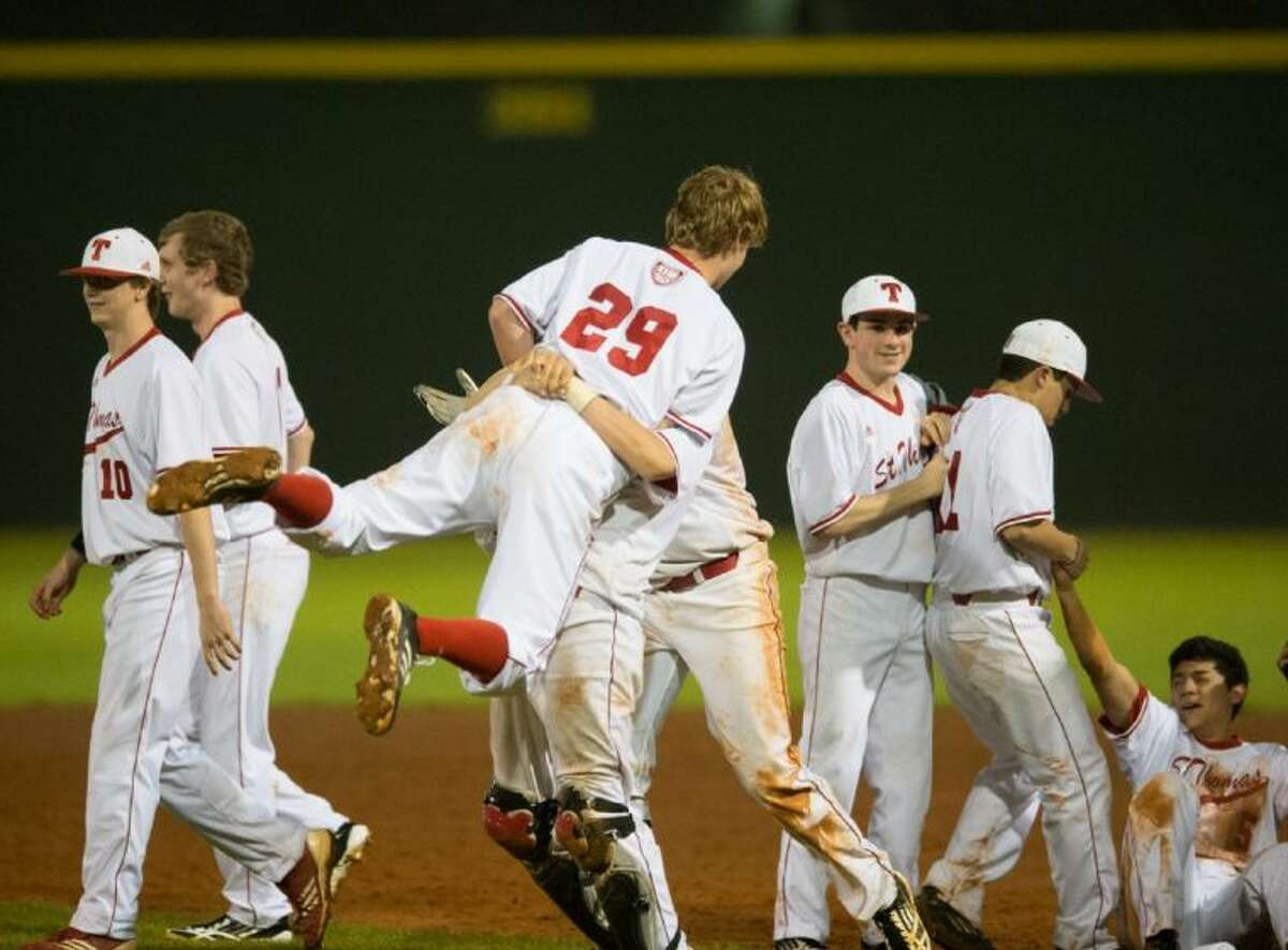 Members of the St. Thomas baseball team celebrate after the Eagles scored four runs in the bottom of the seventh inning to overcome a 3-0 deficit and defeat private school rival Strake Jesuit, 4-3 in a non-district encounter at Hotze Field. St. Thomas will now host its own Father Wilson/Sister Julia tournament starting Thursday morning while Strake Jesuit will play in the Belen Jesuit tournament in Miami, Fla., starting on Friday.