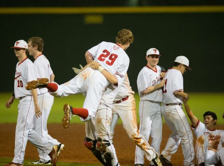 Members of the St. Thomas baseball team celebrate after the Eagles scored four runs in the bottom of the seventh inning to overcome a 3-0 deficit and defeat private school rival Strake Jesuit, 4-3 in a non-district encounter at Hotze Field. St. Thomas will now host its own Father Wilson/Sister Julia tournament starting Thursday morning while Strake Jesuit will play in the Belen Jesuit tournament in Miami, Fla., starting on Friday. Photo: Kevin B Long