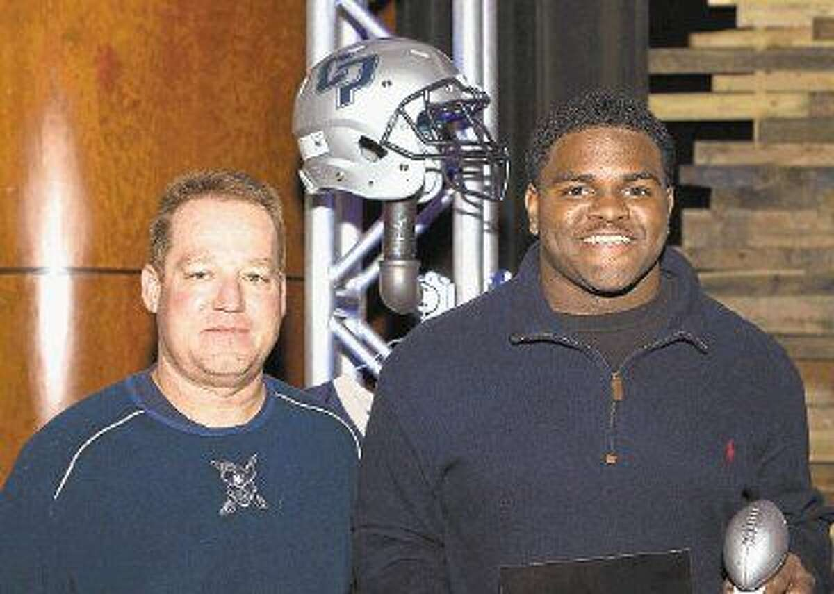 College Park High School Hitman Award winner Roosevelt Henderson, right, pictured with Cavaliers coach Richard Carson.