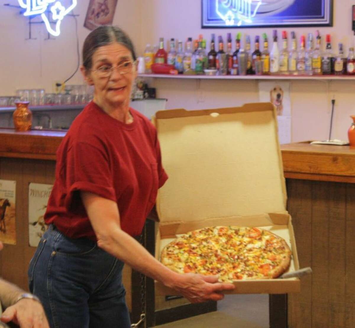 Della Cash showcases her Bacon Chicken Ranch pizza to the Shepherd and Coldspring Chambers of Commerce.