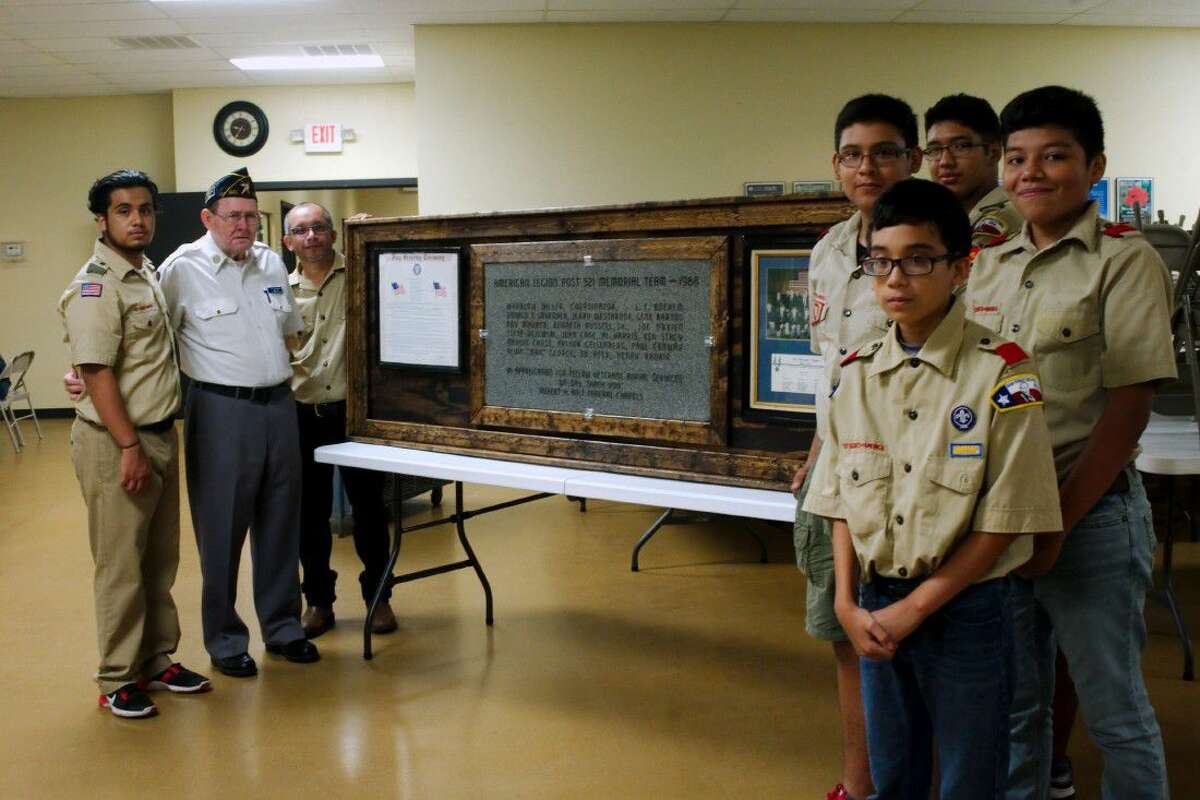 Fellow Troop 504 members stand with Eagle Scout Christian Resendez, left, and American Legion Post 521 2nd Vice Commander Roy Maurer, inside left, after Resendez presents his Eagle service project, a plaque honoring the 1988 Post 521 Memorial Team of which Maurer is a founding member Sauturday, Aug. 13.