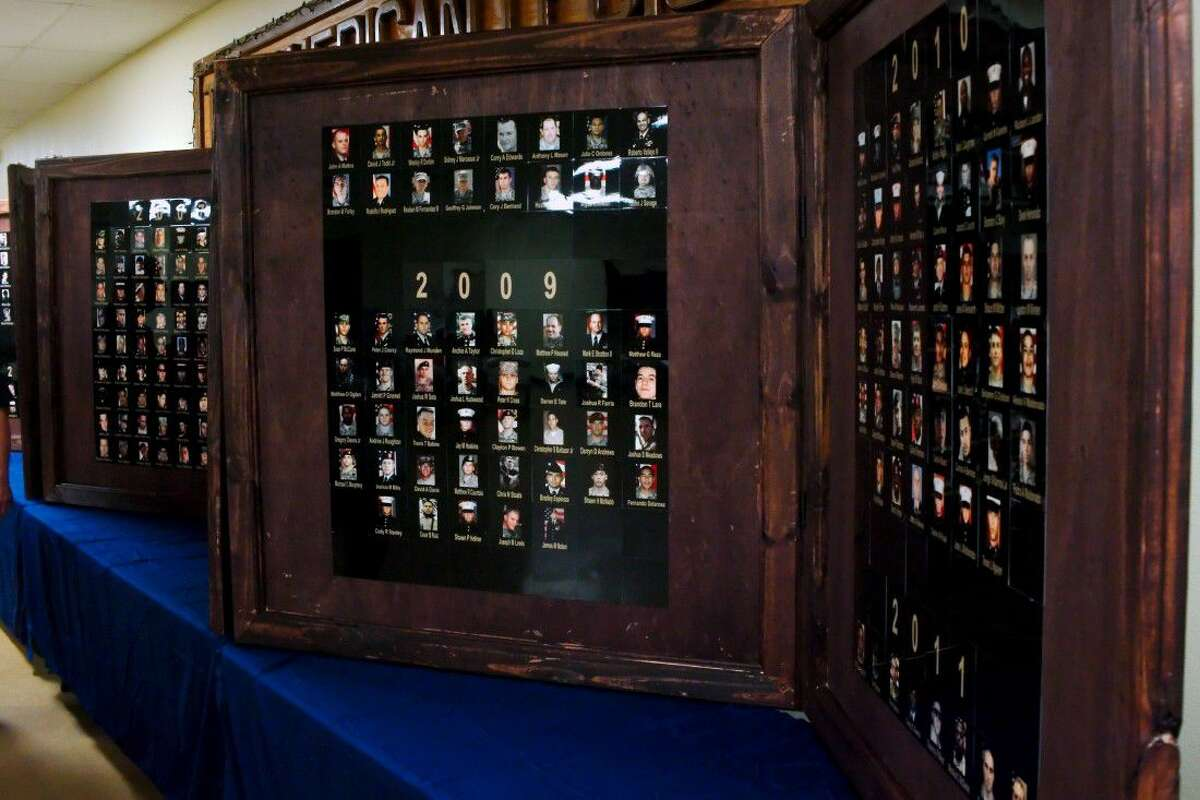 A memorial wall consisting of panels filled with photos of local service men and women who died in Afghanistan or Iraq created as part of a Boy Scout Eagle service project was unveiled at the American Legion Post 521 Saturday, Aug. 13.
