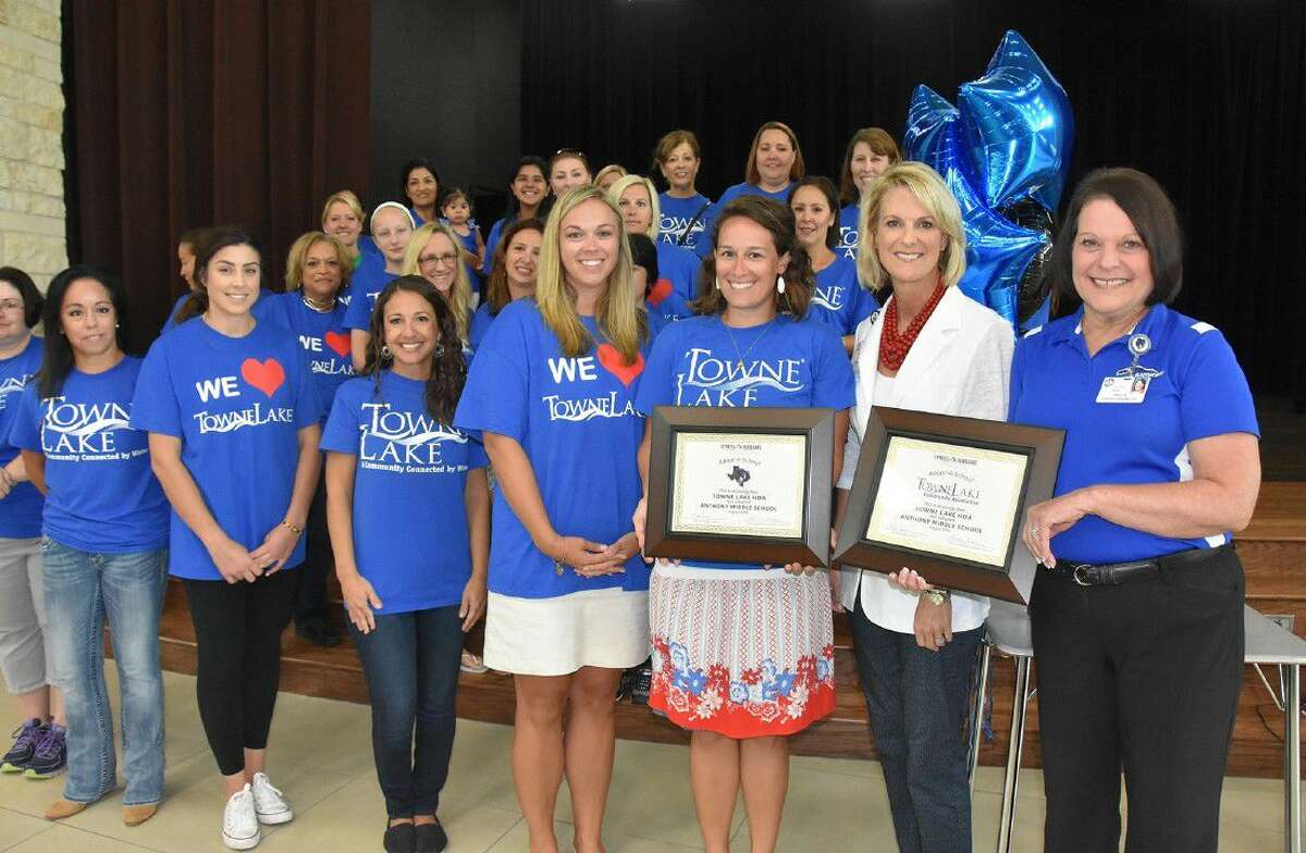 CFISD and Towne Lake representative display adoption certificates formalizing the Adopt-a-School partnership with Anthony Middle School on Aug. 15. Pictured among Towne Lake HOA volunteers are (from right) Sherma Duck, Anthony principal; Leslie Francis, director of marketing and business relations; Alyssa Wilson, Towne Lake lifestyle director; and Jennifer Symons, vice president of marketing for Caldwell Companies.