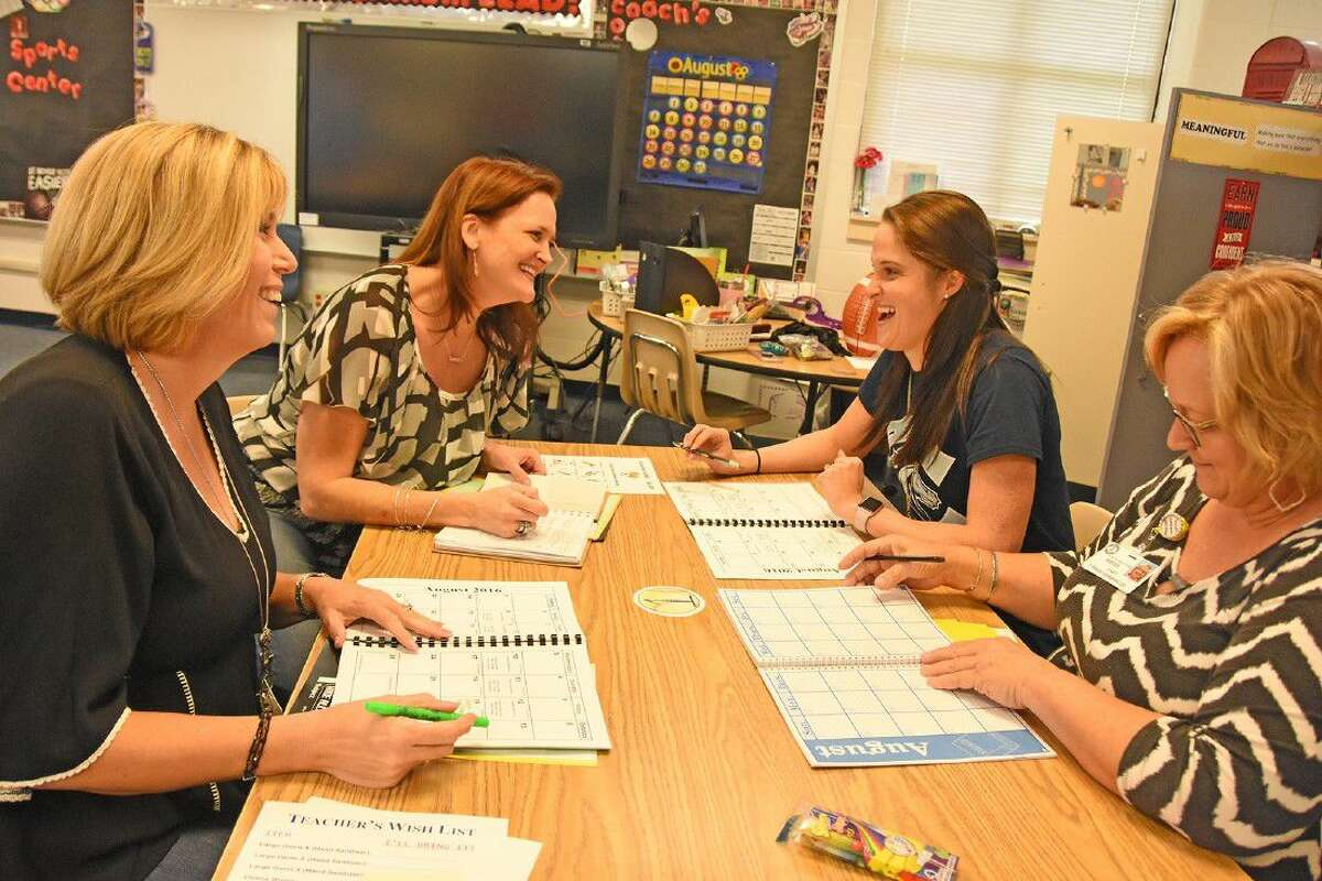 Cammile Adams meets in a planning session with fellow Copeland fifth-grade teachers on Aug. 18, a little more than a week removed from competing in the Rio Olympics.