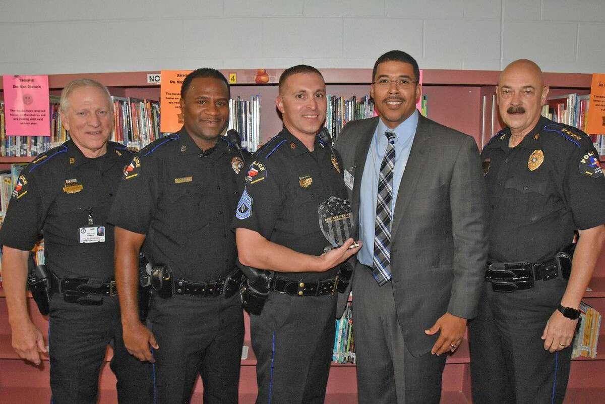 Thornton Middle School and CFISD Police Department representatives present a recognition plaque to CFPD Sgt. Shane Wallace, center, for his service to the Thornton community during the school staff meeting on Aug. 15. Pictured, from left, are Asst. Chief Mike Baker; Thornton Officer Marvin Harris; Sgt. Shane Wallace; Principal Reggie Mitchell; and Chief Alan Bragg.