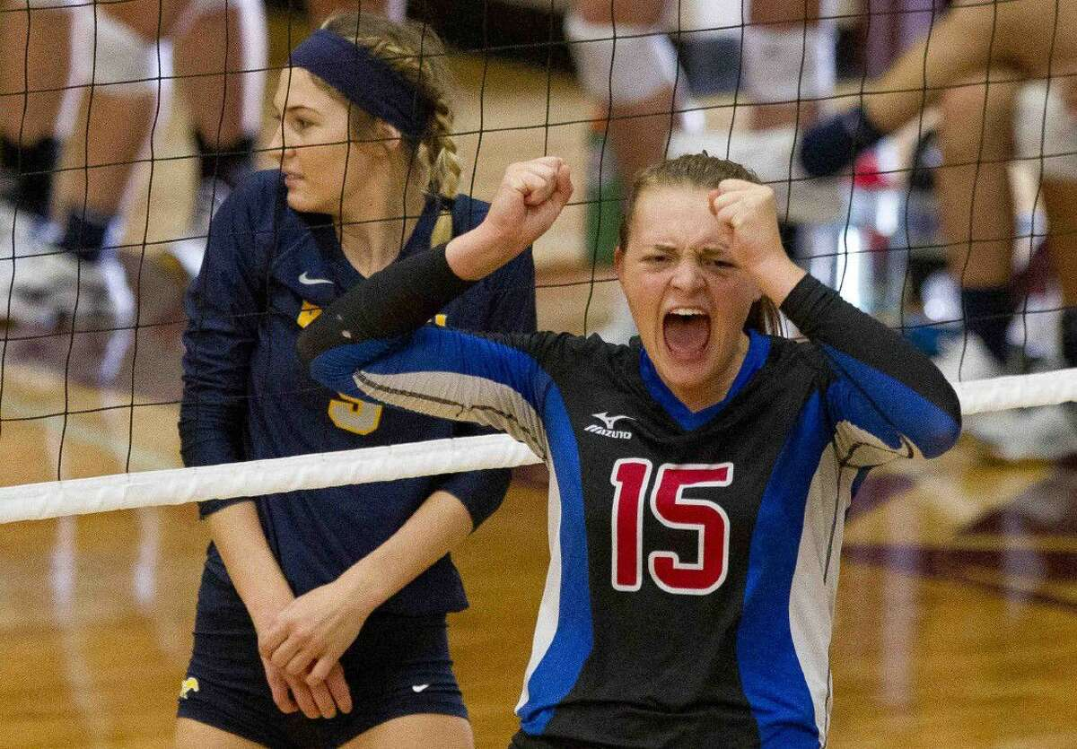 Oak Ridge's Hailey Lohnes celebrates a point during a match agaisnt Cypress Ranch at the Magnolia Volley-Battle tournament Friday at Magnolia High School. Go to HCNpics.com to purchase this photo and other like it.
