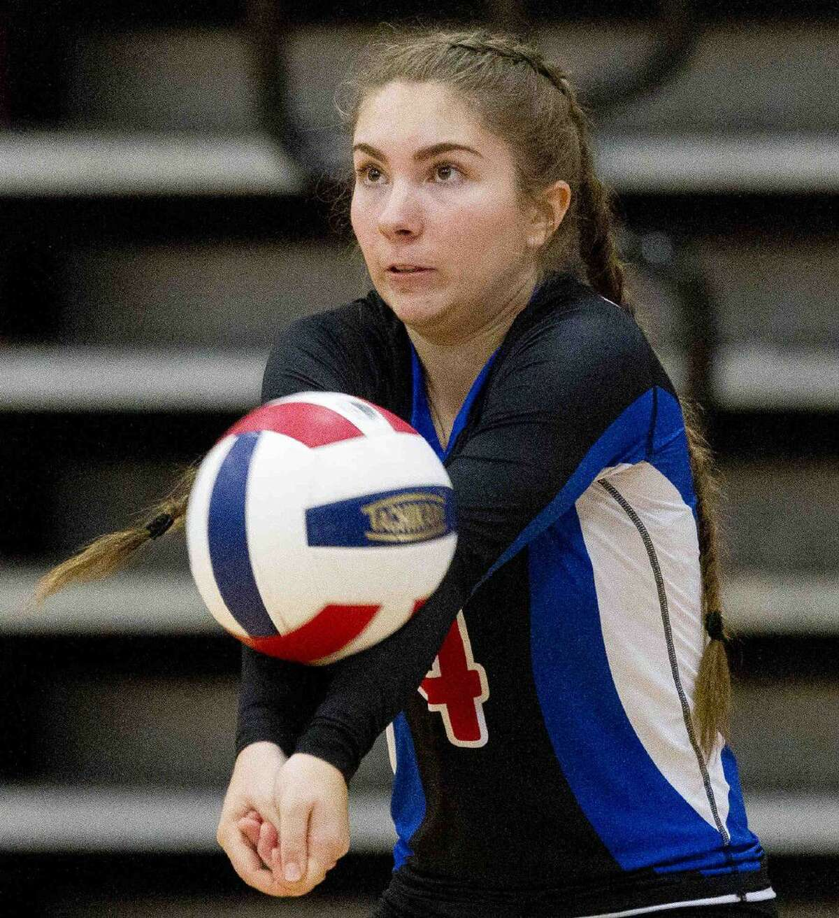 Oak Ridge's Ashlyn Cianciulli returns a serve during a match agaisnt Cypress Ranch at the Magnolia Volley-Battle tournament Friday at Magnolia High School. Go to HCNpics.com to purchase this photo and other like it.