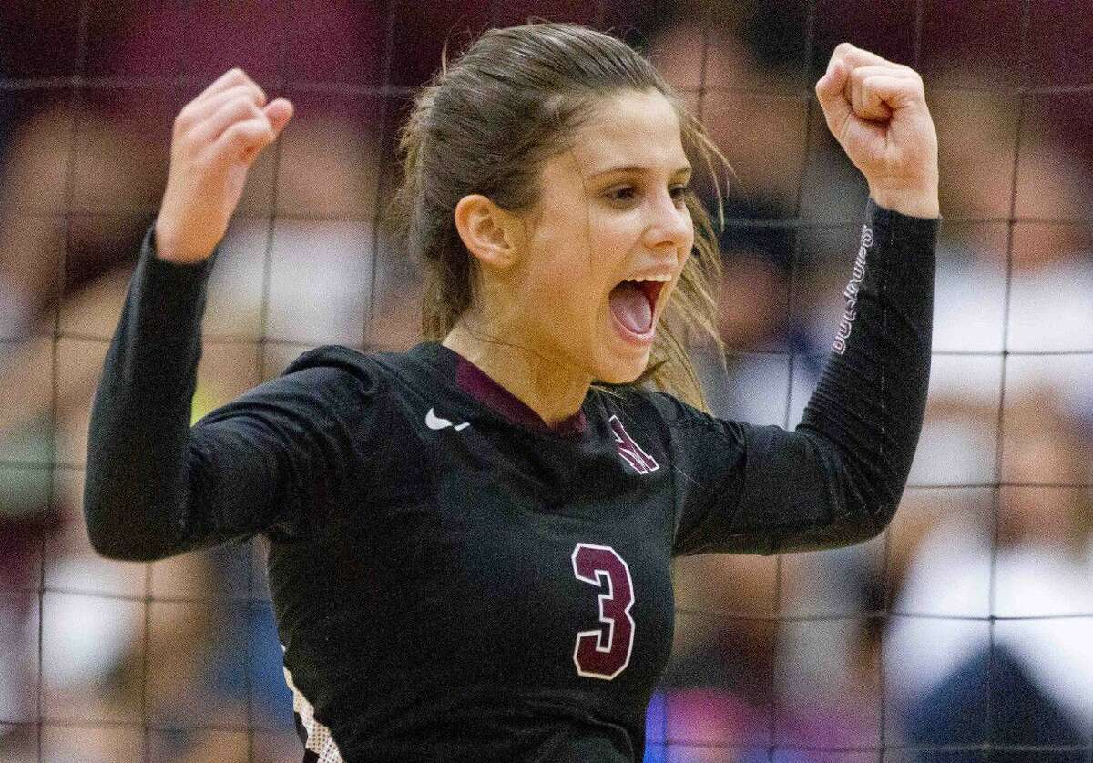 Magnolia's Ally Myers celebrates a point during a match against Willis at the Volley-Battle tournament Friday at Magnolia High School. Go to HCNpics.com to purchase this photo and other like it.