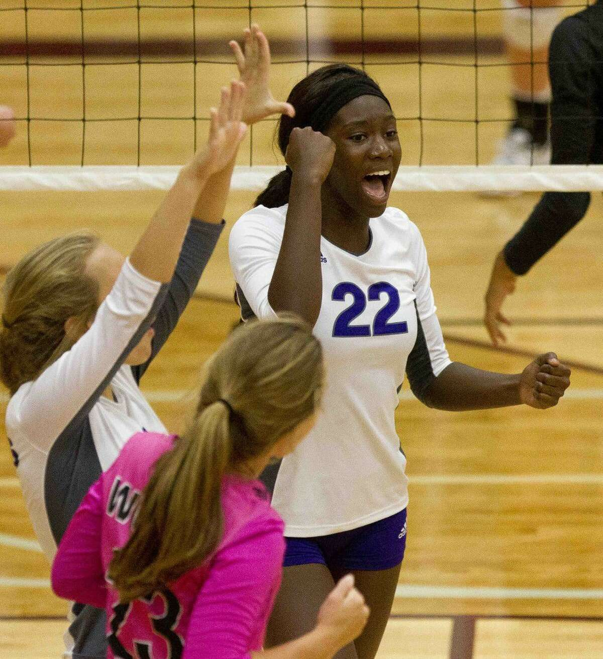 Willis' De'Janae Gilmore (22) celebrates a kill during a match against Magnolia at the Volley-Battle tournament Friday at Magnolia High School. Go to HCNpics.com to purchase this photo and other like it.
