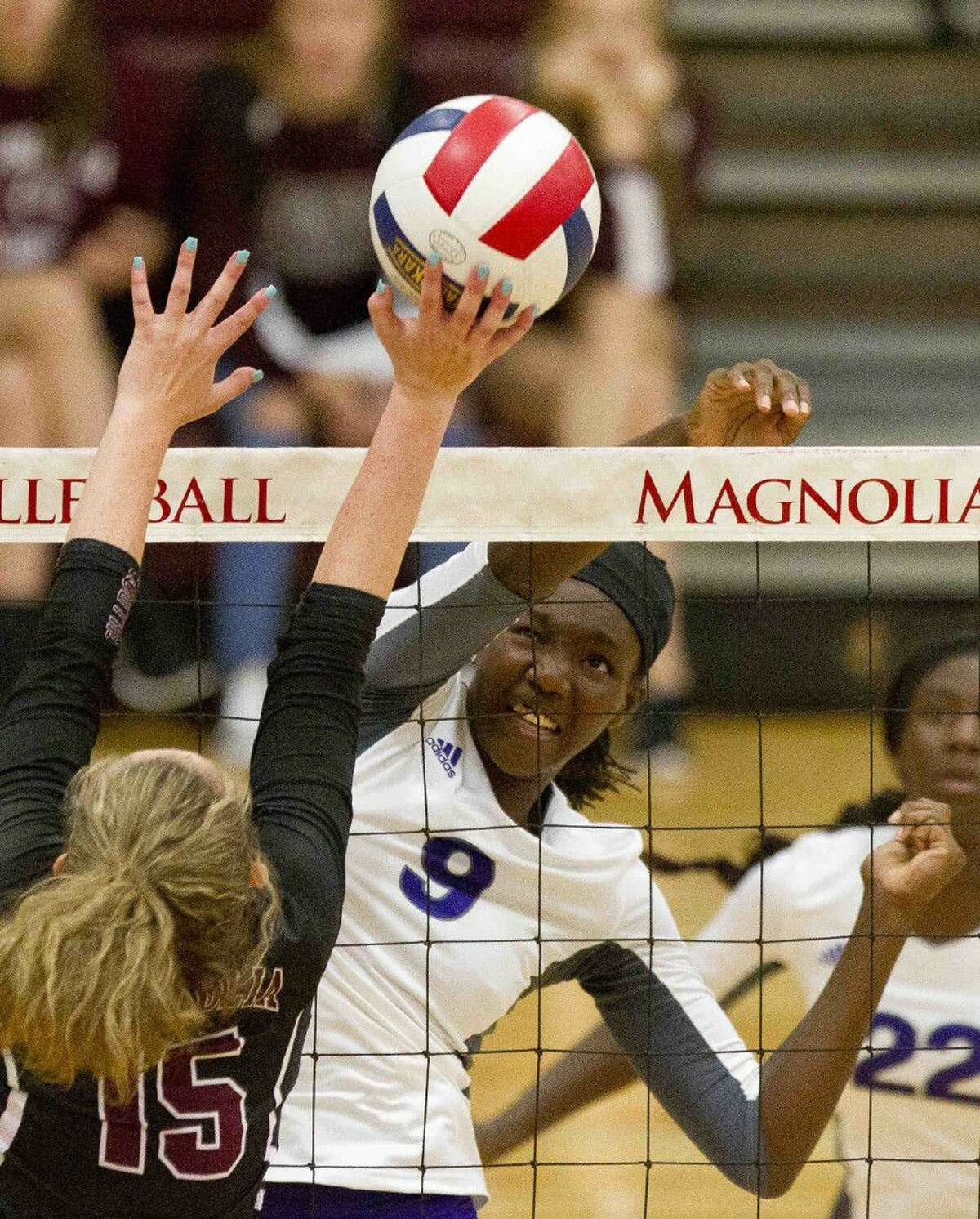 Willis' De'Janae Gilmore gets a shot past a Magnolia blocker during a match at the Volley-Battle tournament Friday at Magnolia High School. Go to HCNpics.com to purchase this photo and other like it.