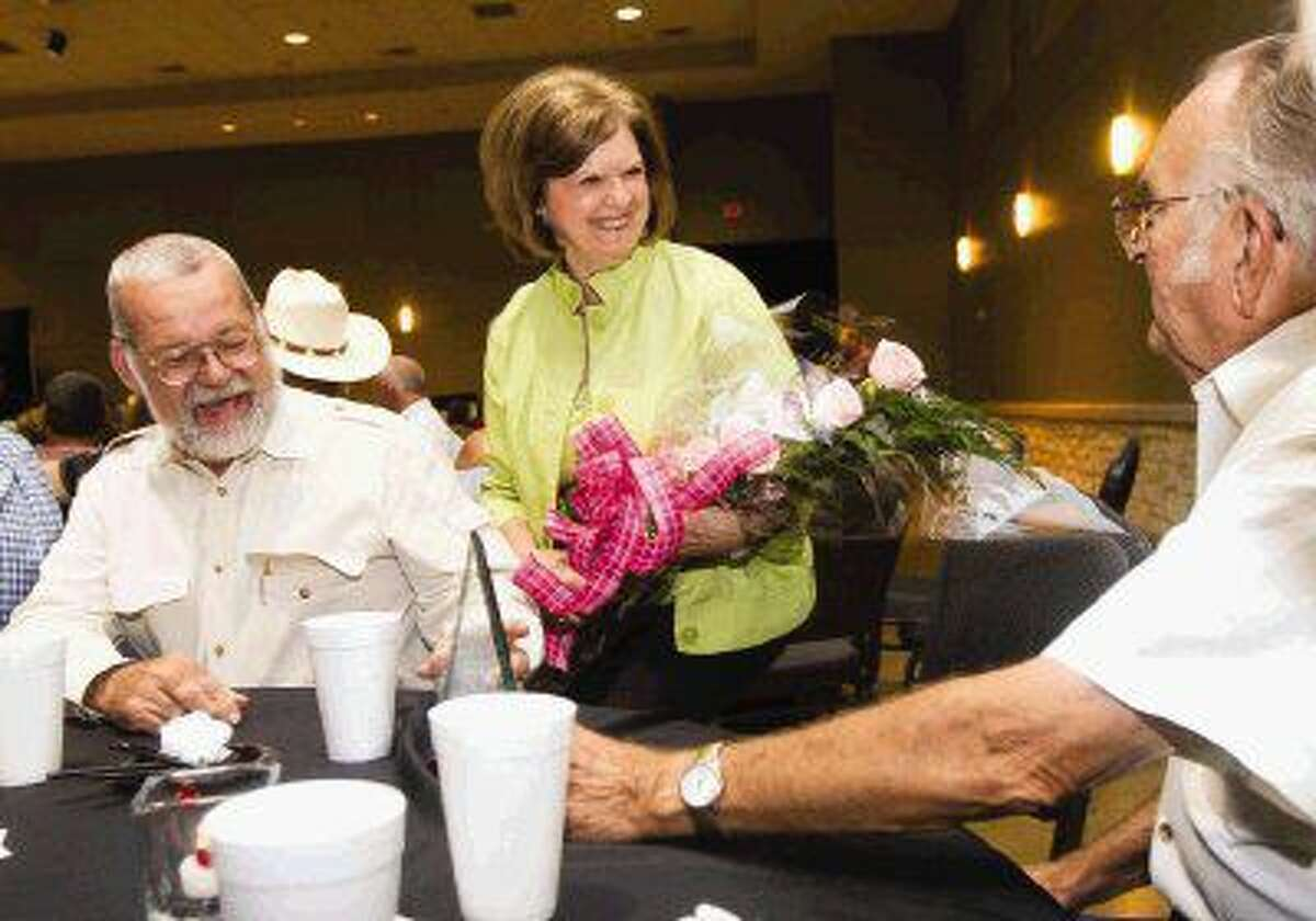 Beth Traylor, center, received the distinguished service award during the annual Montgomery County Fair and Rodeo appreciation dinner Saturday at the Lone Star Convention & Expo Center.