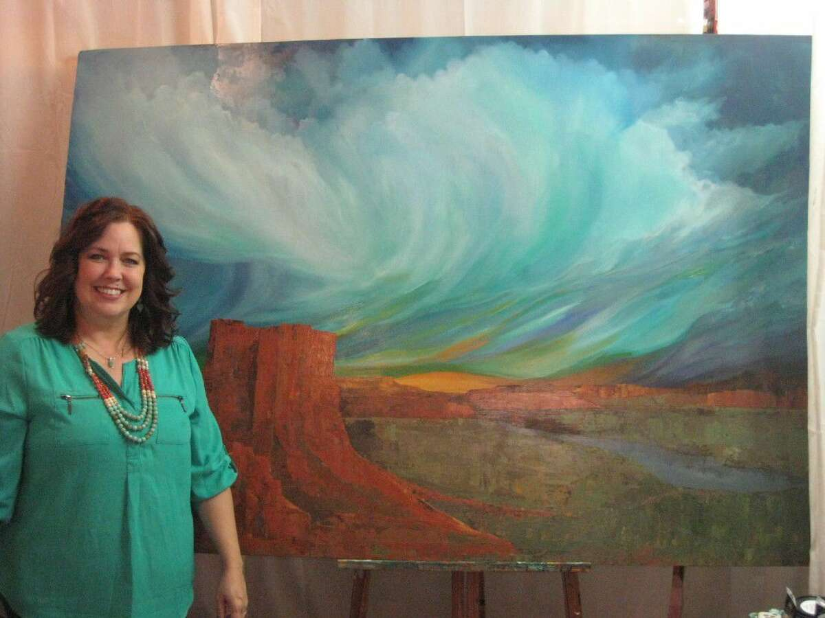 Kingwood artist Holly Nowak stands with one of her pieces that will be featured in