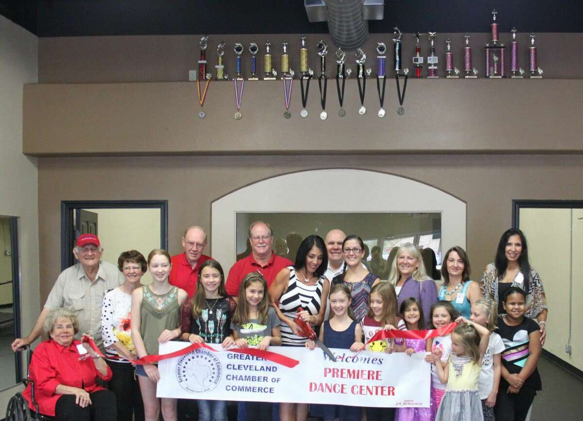Julie Fly cuts the ribbon for her dance studio, Premiere Dance Centre, commemorating her joining of the Greater Cleveland Chamber of Commerce on Aug. 17.