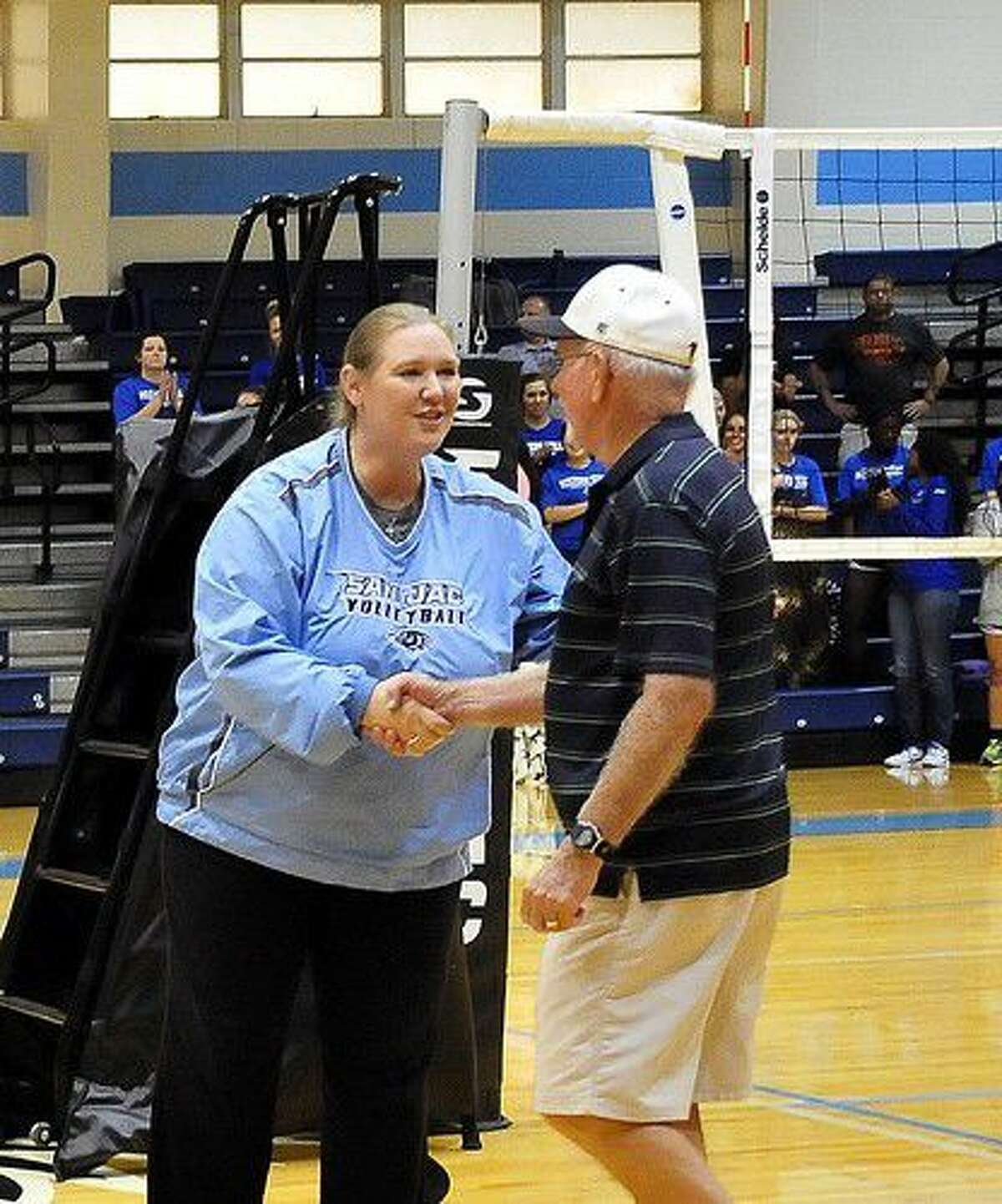 This year's San Jacinto College Military Appreciation Volleyball Tournament,Sept. 1-3, will feature 12 volleyball teams from around the country, a reception honoring military veterans, food vendors, music and tailgating activities. Pictured is San Jacinto College Volleyball Head Coach Sharon Nelson recognizing a military veteran from the audience at last year's military appreciation tournament. Photo credit: Jeannie Peng Mansyur, San Jacinto College marketing, public relations, and government affairs department.