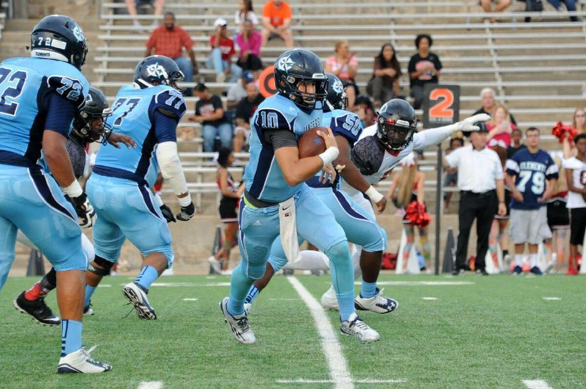 Clements quarterback Nicholas Infante scrambles against Austin as Rashawn Slater (72), Naveen Jain (77) and Sonje Washington (50) head downfield during a 2015 district game at Mercer Stadium. The Rangers have a new coach in CHS alumnus Bobby Darnell.