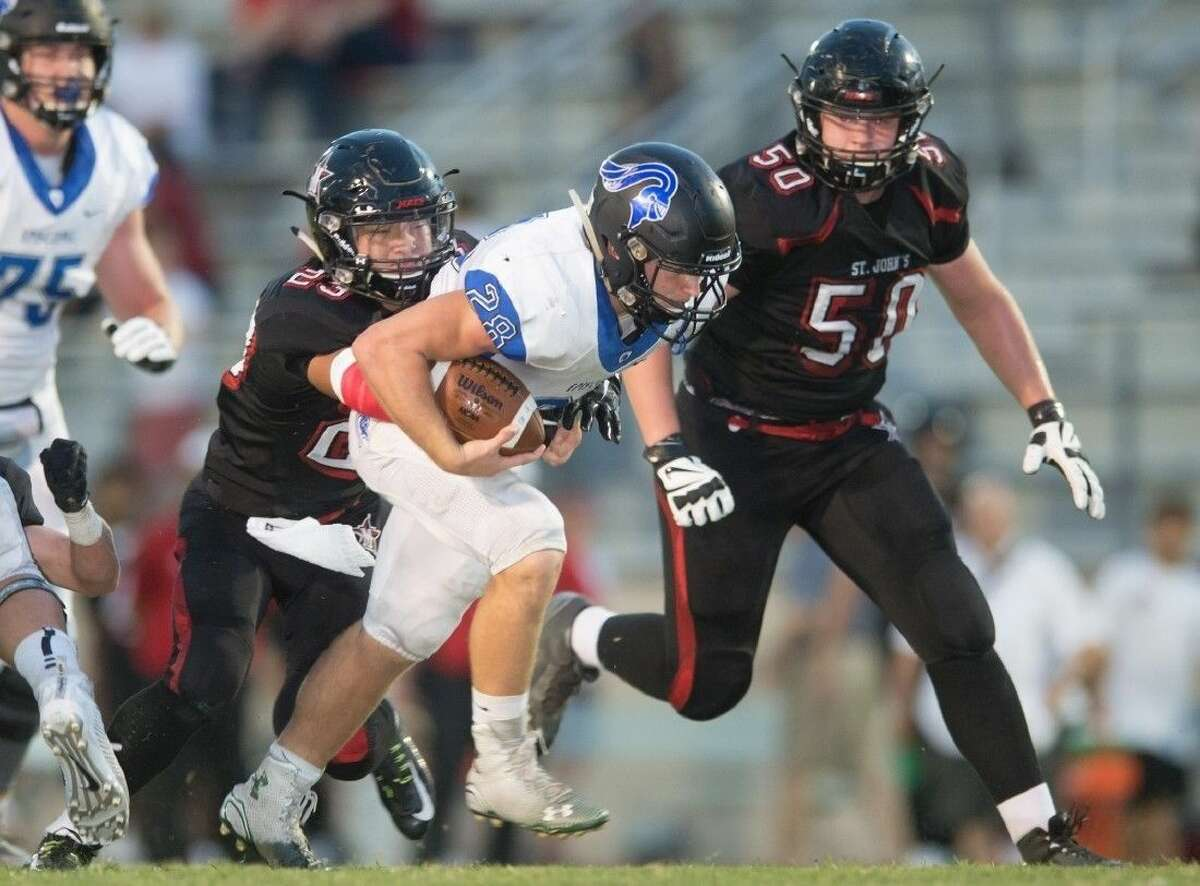 St. John's linebacker Peter Chen chases down Episcopal's Jake LeVrier during a 2015 Southwest Preparatory Conference game. Both will play in the conference's Class 4A division this year.