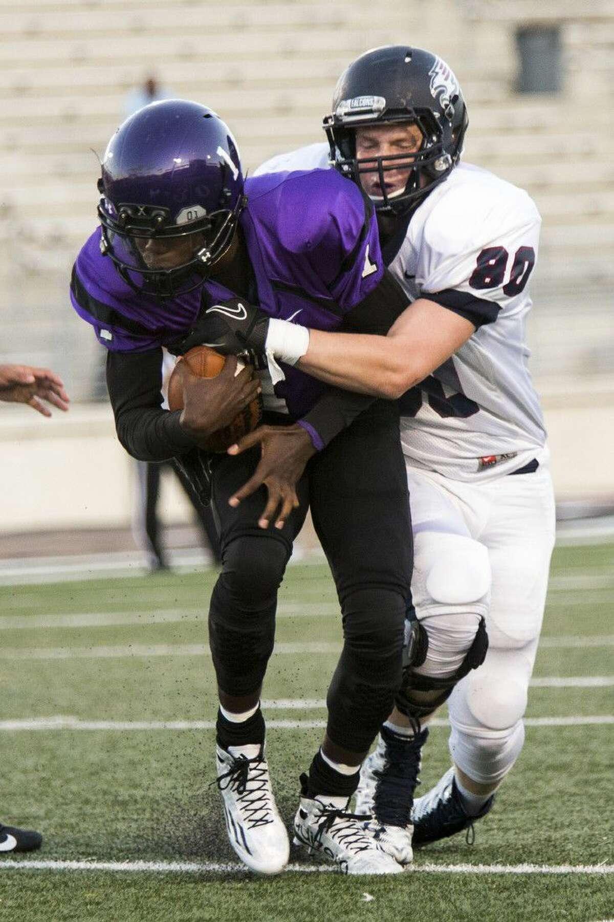 Tompkins linebacker Noah Kalbfleisch (80) sacks Humble quarterback Terrance Gipson (1) during their 2015 season opener. The Falcons earned the first three wins in program history and return 11 starters seeking more.