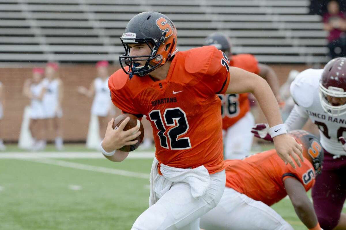 Seven Lakes quarterback Dalton Wood runs against Cinco Ranch during their 2015 district game at Rhodes Stadium. The Spartans aim for their third playoff appearance in five years. To view or purchase this photo and others like it, visit HCNpics.com.