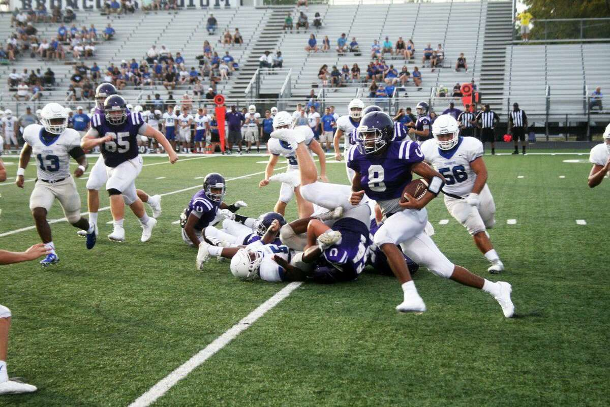 Senior Bronco Kendrec Gaines sweeps around the left side in the Broncos win over Clear Springs in a scrimmage game. Gaines is expected to play a big part in the offense this fall.