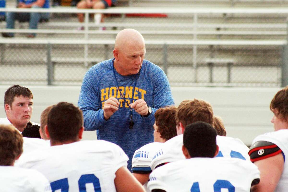 Head Coach Tod Stark gives final instructions to his Hardin Hornets team before their scrimmage against Liberty. The Hornets hosted the game at their stadium last Friday night.
