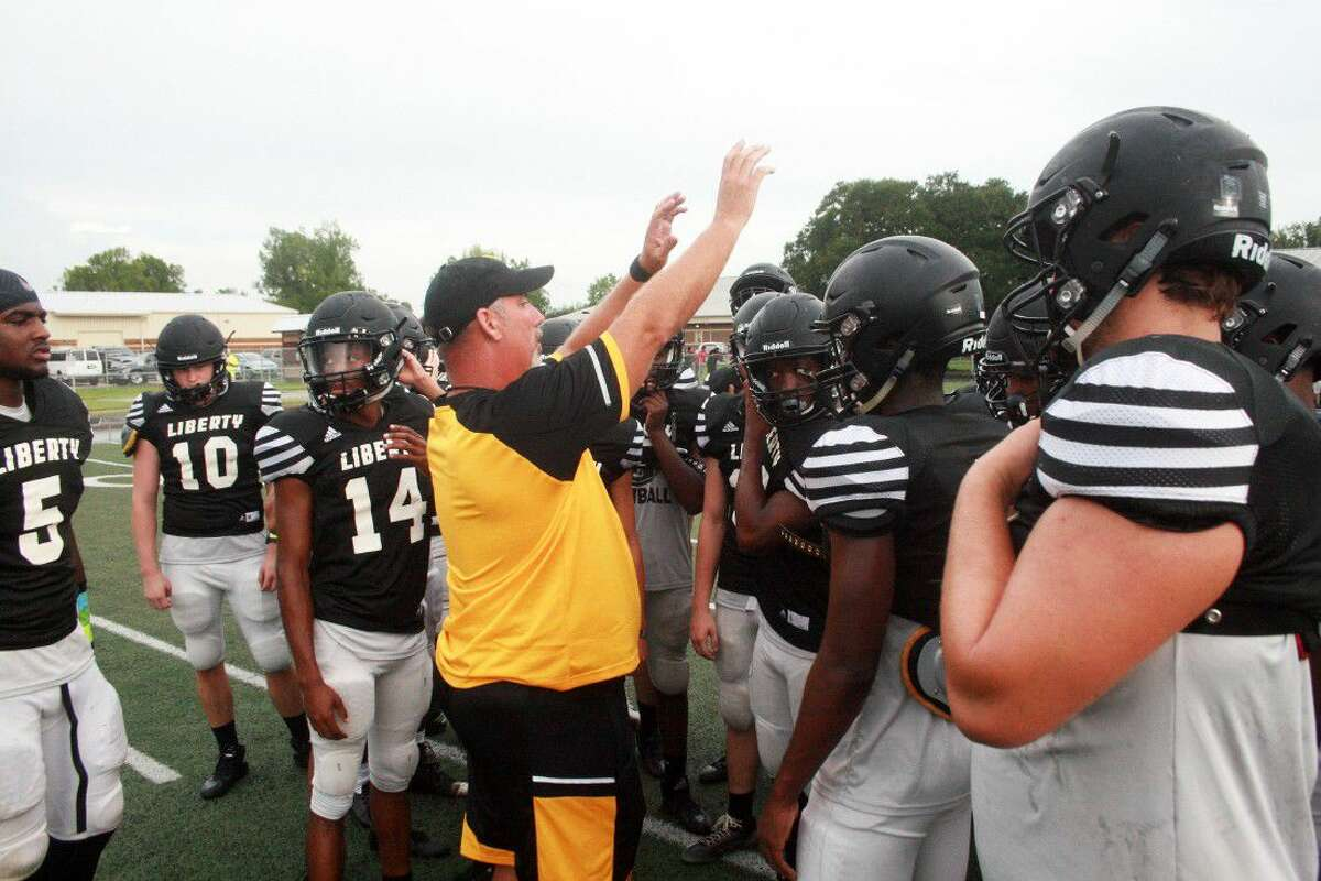 Head football coach Chad Taylor gives last minute instructions to his team before their scrimmage with Hardin last Friday night at Hornet Stadium.