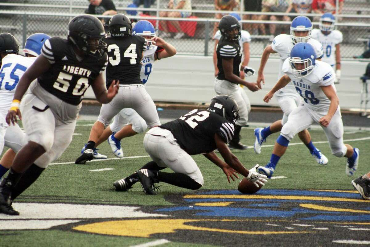 Slick rain conditions on the field caused a number of turnovers in the last scrimmage of the season for the two opponents. The Panthers scramble for a fumbled football in Friday night's game against Hardin.