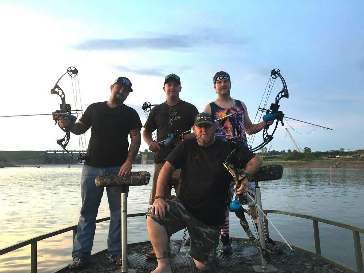 Johnathon Hubbard (center) and the Wicked Water Outfitters get ready to enjoy a day of bow fishing. Pictured are (back row) James Black, Hubbard, Zane Vestal and (front row) Joel Dudley.
