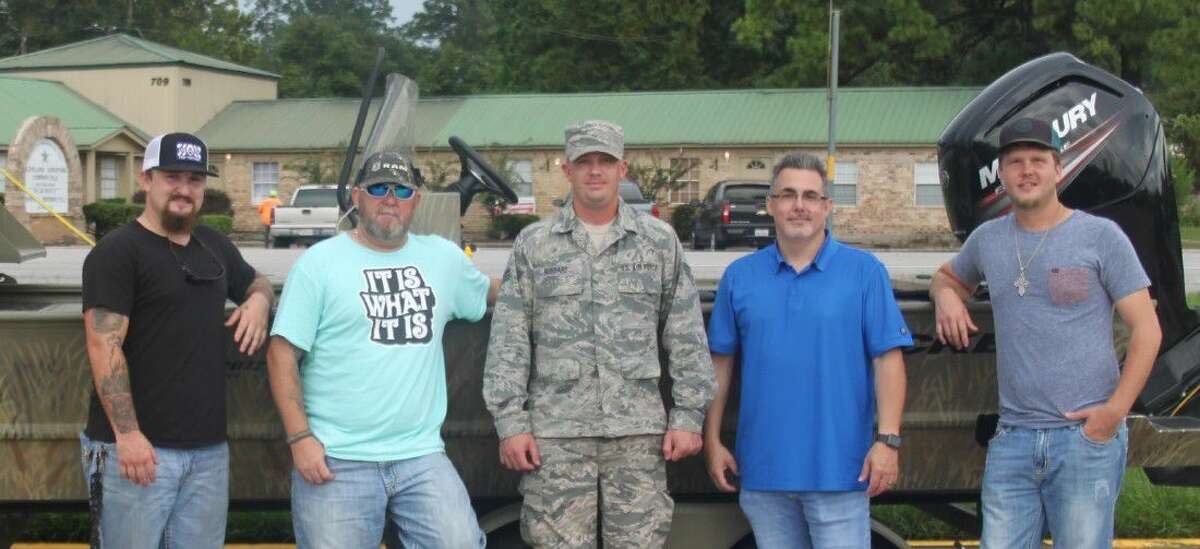 Senior Airman Johnathon Hubbard (center) is the recipient of a bow fishing trip from the Wicked Water Outfitters as part of their Wicked Water Warriors project for veterans and United States military. Joel Dudley (second from left) of Wicked Water Outfitters took Hubbard to Lake Livingston on Aug. 20 for the trip. Pictured left to right are James King, Dudley, Hubbard, Robert White and Zane Vestal.