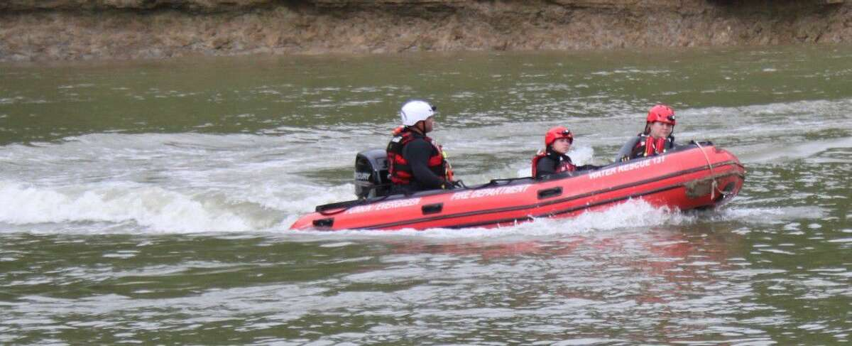 Firefighters from Coldspring and Punkin-Evergreen volunteer fire departments practice using a fast boat for future rescue operations.