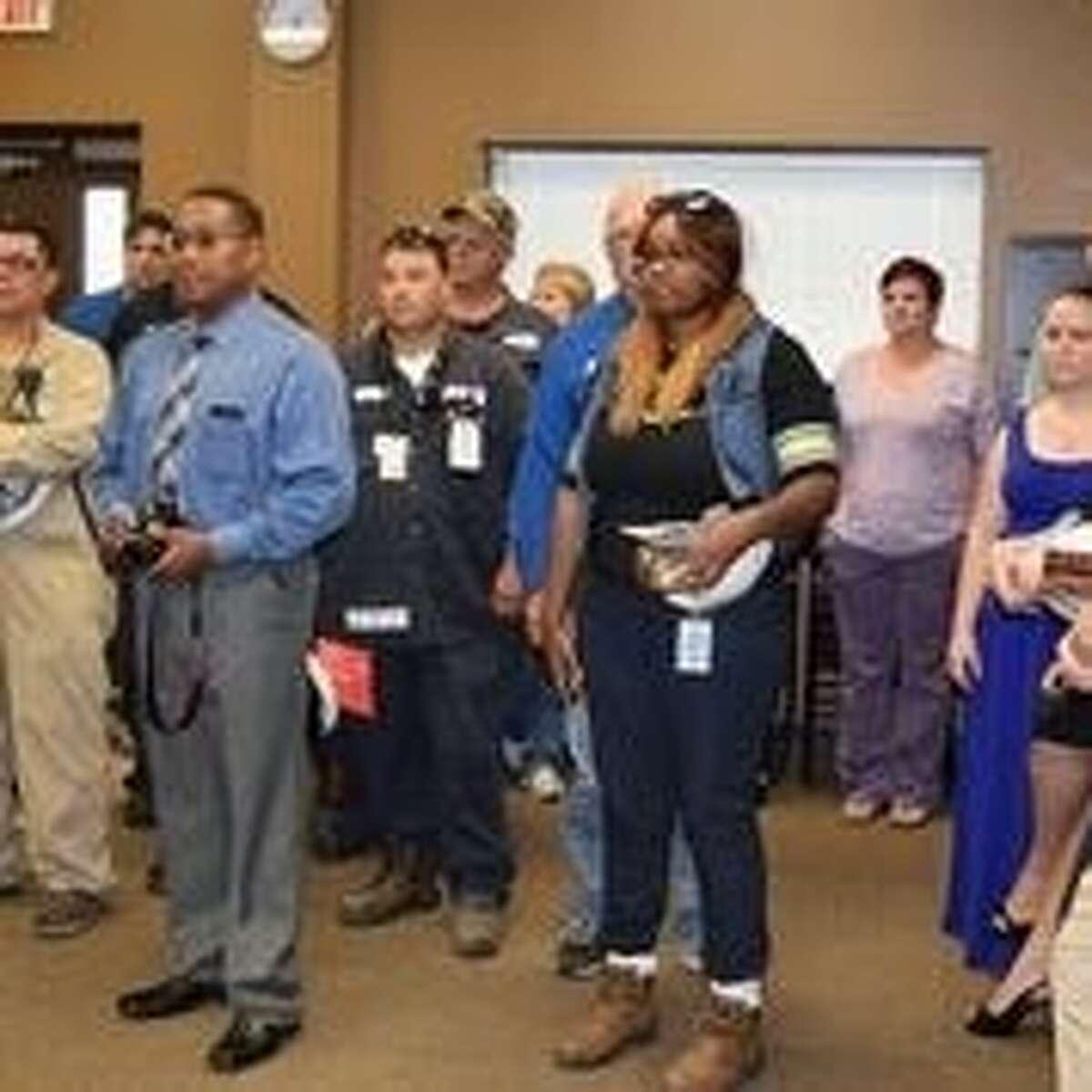 Kaneka North America LLC employees celebrate the opening of the Kaneka North America Learning and Education Center.