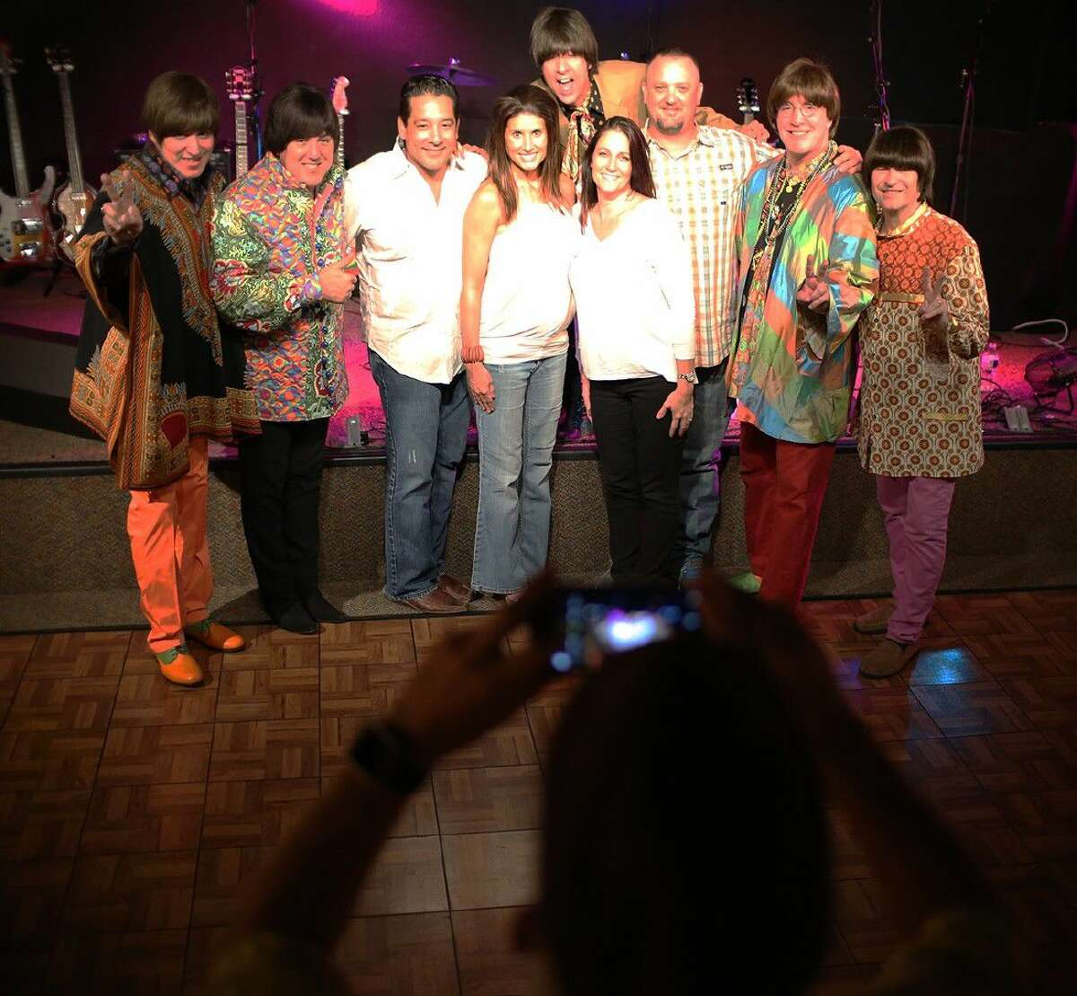 The Beatles tribute band The Fab 5 takes selfies with fans after their concert during the 2016 Alvin Live Summer Series on August 11.