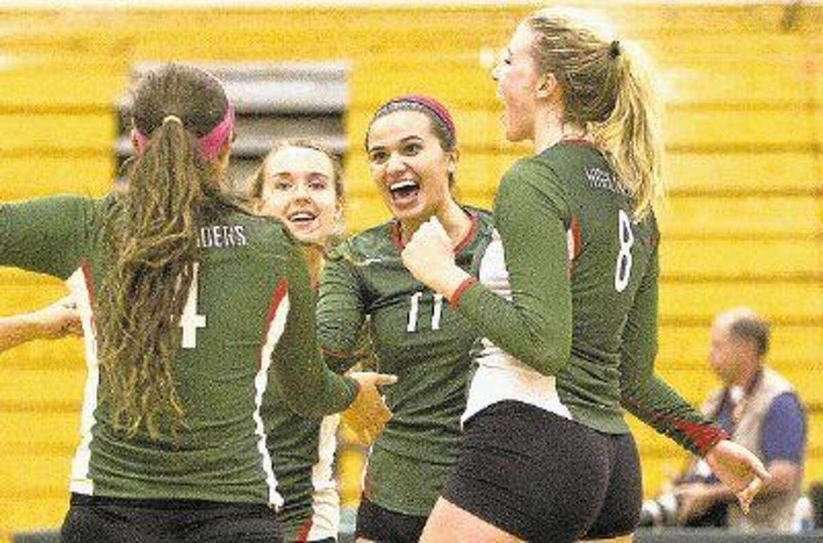 The Woodlands' Courtney Quinn (11), Kendall Cook (4) and Rachel Reed (8) are returning to the state tournament after helping the Lady Highlanders win the Class 5A title last season.