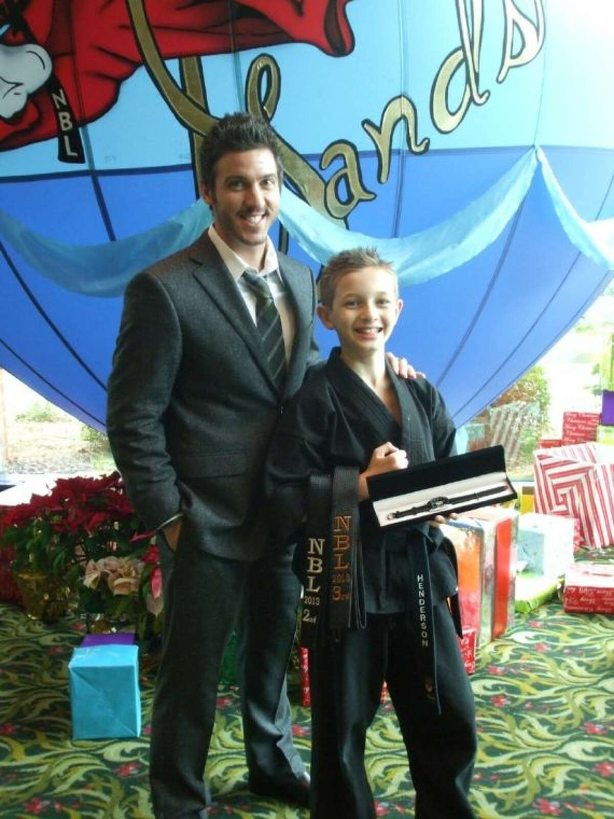 Theiss Elementary School student Sean Henderson recently beat out students from around the world to win two world titles in the 17 under junior black belt choreographed musical forms division and the 11 and under junior black hard creative weapons.